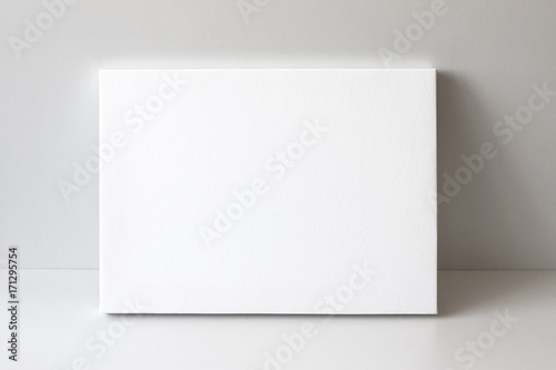 Fototapeta White empty canvas. Gray wall on background. Mock up poster frame, canvas template. obraz