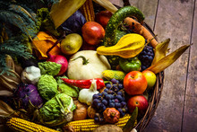 Heap Of Fresh Fruits And Vegetables In Basket