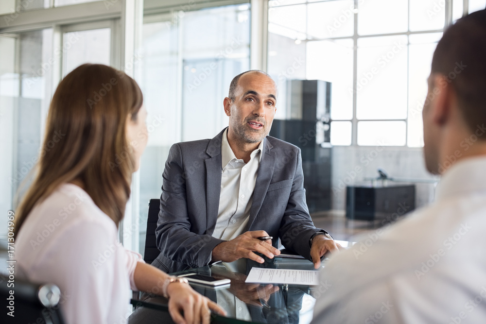 Fototapeta Financial advisor with clients