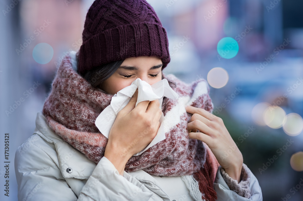 Fototapety, obrazy: Woman blowing nose outdoor
