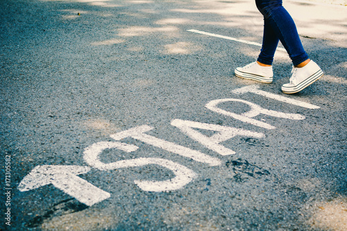 Fototapeta Feet of women with start word on road concept keep going ,hipster tone obraz