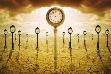 Time after death concept. Clock with no hands among many other showing different times