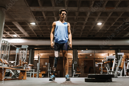 Photo Portrait of disabled young in the gym.