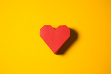 Red Paper Heart On A Yellow Ba...
