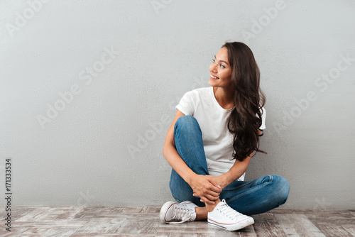 Attractive young asian woman sitting