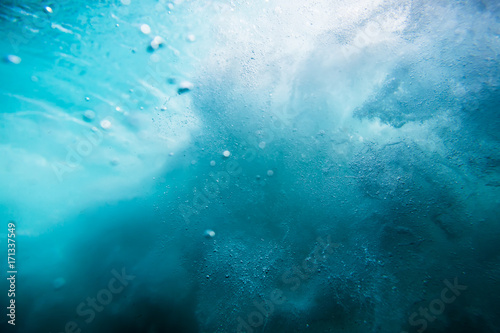 Wave texture underwater. Blue ocean in underwater