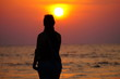 Female doing yoga on the sunset, asana pose, silhouette of the young girl, freedom moments