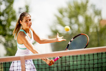 Young Woman Playing Tennis Out...