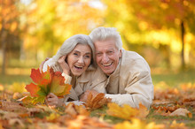 Caucasian Senior Couple With Leaves