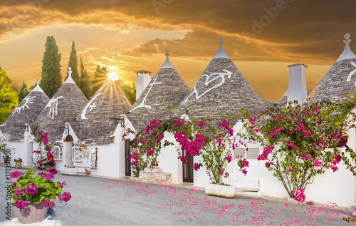 Trulli houses in Alberobello city at sunset time,  Apulia, Italy. Wallpaper Mural