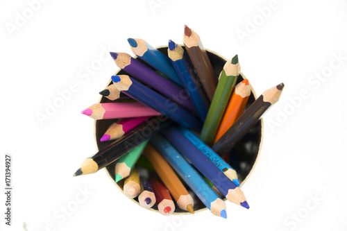 Fotografie, Obraz  Spiral of colored pencils isolated on white.