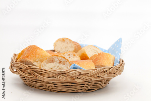 a slice of french bread on basket Canvas-taulu