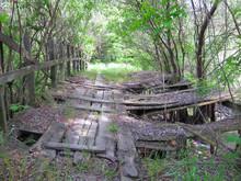 Very Old Damadged Wooden Hanging Footbridge Across River