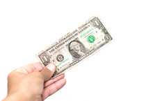 Poverty. Pay The Debts. Hand Holding (gives) Shabby One Dollar Isolated On White.