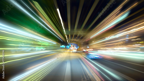 Pinturas sobre lienzo  Moving forward motion blur background with light trails ,night scene