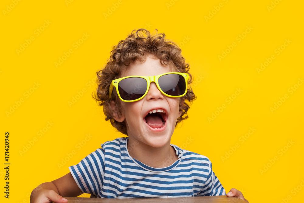 Fototapety, obrazy: Adorable kid in bright sunglasses on orange