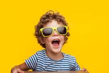 Adorable Kid In Bright Sunglas...