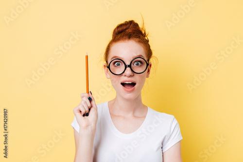 Slika na platnu Happy ginger woman in eyeglasses having idea