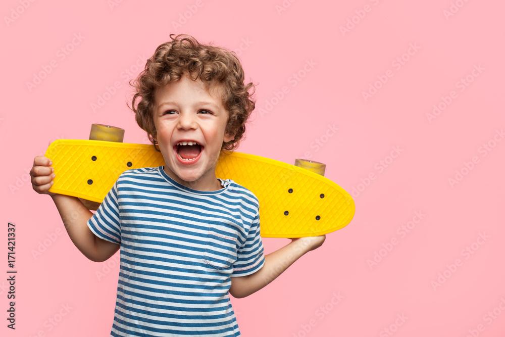 Fototapety, obrazy: Cheerful boy with yellow longboard