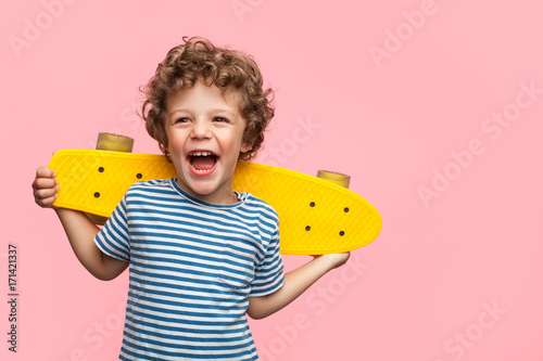Fotografie, Obraz  Cheerful boy with yellow longboard