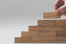 Male Hand Stacking Wooden Bloc...