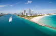 canvas print picture - Aerial view of South Miami Beach with Pilot boat sailing next to the city line