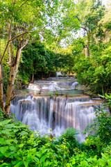 Obraz na SzkleBeautiful waterfall in the national park forest at Huai Mae Khamin Waterfall, Kanchanaburi Thailand