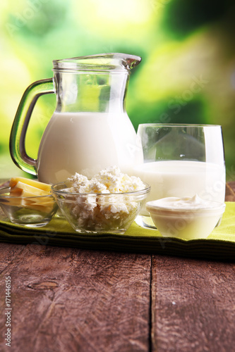 Poster Dairy products milk products. tasty healthy dairy products on a table
