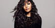 Leinwandbild Motiv Attractive brunette with long curly hair