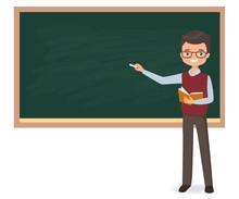 Young Male Teacher Is Writing Chalk On A School Blackboard