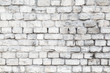 The old stone walls. The brick wall of the house. Grey textured background. Abstraction.
