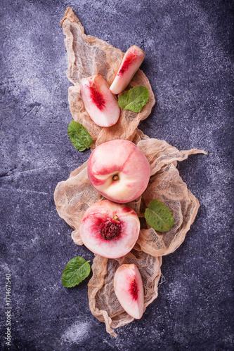 fresh-ripe-peaches-on-concrete