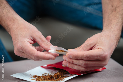 hands rolling a cigarette Poster