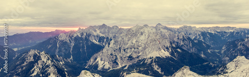 Papiers peints Beige Panoramic view of mountain ridge at sunrise.