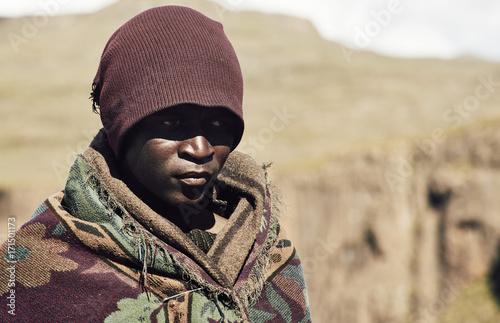 Portrait of a black Basotho shepherd wrapped in a traditional blanket.