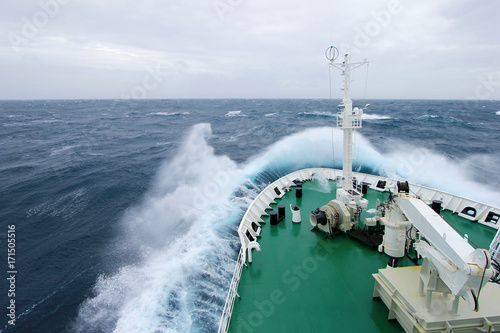 Staande foto Antarctica Ship's Bow diving into a big splashing wave, antarctic ocean, Antarctica