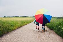 Children Walking On A Rainy Da...