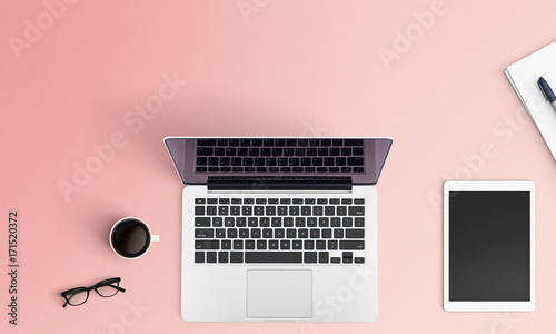 Modern workspace with notebook or laptop, coffee cup and tablet copy space on color background. Top view. Flat lay style.