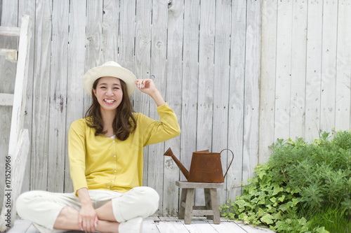 Woman with hat relaxing on terrace