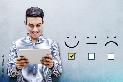 Fotografía  Customer Experience Concept, Happy Businessman holding digital Tablet with a che