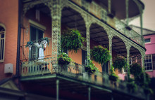 House With An Old Balcony. Scenic Colorful Streets Of New Orleans, Louisiana