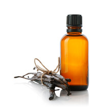 Bottle With Vanilla Extract And Sticks On White Background