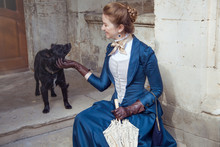 Vintage Young Beautiful Lady With Black Dog Outdoors. Victorian Style