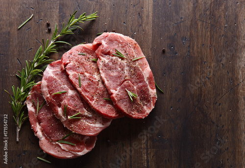 Fotografie, Obraz  Pork steak with rosemary and pepper , free space for your text