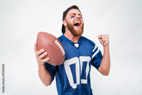 Excited screaming man fan holding rugby ball. - 171560178