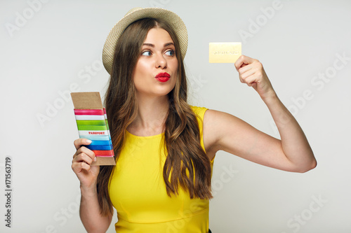 Fototapeta Happy smiling woman with passport and gold credit card. obraz