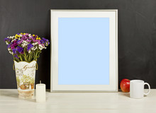 Silver Frame Mockup With Field Flowers In Vase, Apple, Mug And Candle