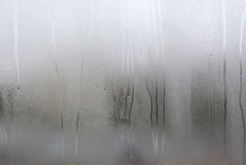 Fototapeta Window with condensate or steam after heavy rain, large texture or background