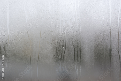 Window with condensate or steam after heavy rain, large texture or background Tablou Canvas