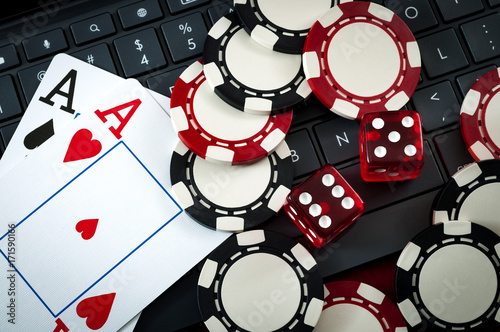 фотография  Internet casino and online gambling concept with two cards (aces) on a keyboard,